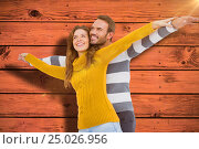 Купить «Composite image of young couple standing with arms outstretched», фото № 25026956, снято 19 января 2019 г. (c) Wavebreak Media / Фотобанк Лори