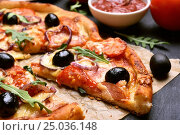 Купить «Pizza with tomato, salami and olives», фото № 25036148, снято 27 января 2017 г. (c) Татьяна Волгутова / Фотобанк Лори
