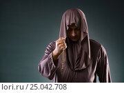 Купить «Monk in religious concept on gray background», фото № 25042708, снято 26 октября 2016 г. (c) Elnur / Фотобанк Лори