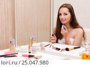Купить «Woman doing make-up at home preparing for party», фото № 25047980, снято 5 сентября 2016 г. (c) Elnur / Фотобанк Лори