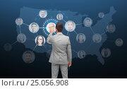 Купить «businessman touching virtual screen with contacts», фото № 25056908, снято 29 января 2015 г. (c) Syda Productions / Фотобанк Лори