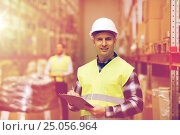 Купить «man with clipboard in safety vest at warehouse», фото № 25056964, снято 9 декабря 2015 г. (c) Syda Productions / Фотобанк Лори