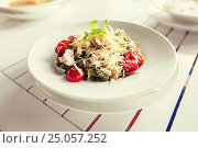 Купить «close up of pasta with tomato and cheese on plate», фото № 25057252, снято 20 сентября 2015 г. (c) Syda Productions / Фотобанк Лори
