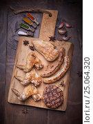 Купить «Various meats grill, food background, wood background», фото № 25064320, снято 12 января 2017 г. (c) Sergey Knyazev / Фотобанк Лори