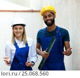 Купить «Smiling technicians smoothing the wall», фото № 25068560, снято 25 июня 2019 г. (c) Яков Филимонов / Фотобанк Лори