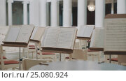 Dolly shot of note sheets on music stands on scene in concert hall. Стоковое видео, видеограф Александр Багно / Фотобанк Лори