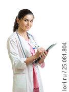 Купить «Beautiful smiling woman doctor hold pen filling patient history list at clipboard pad. Healthy lifestyle concept», фото № 25081804, снято 26 сентября 2014 г. (c) Оксана Кузьмина / Фотобанк Лори