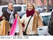 Купить «Portrait of smiling cheerful mature couple standing», фото № 25082720, снято 22 ноября 2018 г. (c) Яков Филимонов / Фотобанк Лори