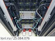 Купить «Rack in the data center», фото № 25084076, снято 24 марта 2019 г. (c) Mikhail Starodubov / Фотобанк Лори