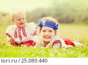 Купить «Happy children in russian folk clothes», фото № 25089440, снято 15 июня 2013 г. (c) Яков Филимонов / Фотобанк Лори