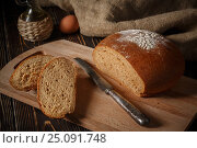 Rye bread lies on a breadboard. Стоковое фото, фотограф Максим Стриганов / Фотобанк Лори