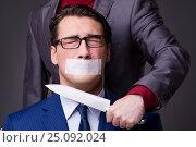 Купить «Businessman taken hostage and tied up with rope», фото № 25092024, снято 21 октября 2016 г. (c) Elnur / Фотобанк Лори