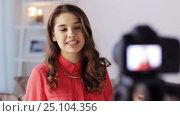 Купить «woman with camera recording video at home», видеоролик № 25104356, снято 3 января 2017 г. (c) Syda Productions / Фотобанк Лори