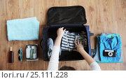 Купить «hands packing travel bag with personal stuff», видеоролик № 25111228, снято 13 января 2017 г. (c) Syda Productions / Фотобанк Лори