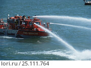 Купить «Fire rescue boat firing water from hoses, Newport, Rhode Island, USA.», фото № 25111764, снято 16 октября 2019 г. (c) Nature Picture Library / Фотобанк Лори