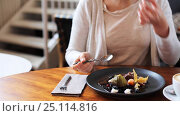 Купить «woman eating ice cream dessert with coffee at cafe», видеоролик № 25114816, снято 17 января 2017 г. (c) Syda Productions / Фотобанк Лори