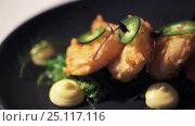 Купить «close up of prawn salad with jalapeno and wakame», видеоролик № 25117116, снято 17 января 2017 г. (c) Syda Productions / Фотобанк Лори
