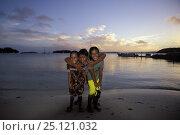 Купить «Local children on the beach at sunset in the Vava'u group, Tonga, Pacific Ocean Islands. 2000», фото № 25121032, снято 22 сентября 2019 г. (c) Nature Picture Library / Фотобанк Лори