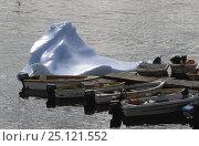 Купить «A small iceberg and local fishing doreys lined up on the pontoon at Qeqertarssuat, Disko Bay, Greenland.», фото № 25121552, снято 16 августа 2018 г. (c) Nature Picture Library / Фотобанк Лори