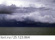 Купить «Stormy Clouds over tropical seas.», фото № 25123864, снято 15 августа 2018 г. (c) Nature Picture Library / Фотобанк Лори