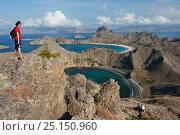 Купить «Hiker looking at view from  Padar Island, Komodo National Park. Indonesia, Pacific Ocean, September 2007.», фото № 25150960, снято 10 июля 2020 г. (c) Nature Picture Library / Фотобанк Лори