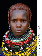 Купить «Young woman of the Nyangatom tribe, with traditional necklaces and hair covered with ochre and animal fat, Omo Valley, Ethiopia, March 2015.», фото № 25154384, снято 2 июля 2020 г. (c) Nature Picture Library / Фотобанк Лори