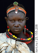 Купить «Young woman from the Toposa tribe, with facial skin scarification and traditional head wear and jewels, Omo Valley, Ethiopia, March 2015.», фото № 25155208, снято 22 мая 2019 г. (c) Nature Picture Library / Фотобанк Лори