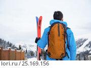 Купить «Skier standing with ski on snow covered mountains», фото № 25169156, снято 18 ноября 2016 г. (c) Wavebreak Media / Фотобанк Лори