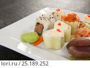 Купить «Set of assorted sushi served in a white plate», фото № 25189252, снято 8 декабря 2016 г. (c) Wavebreak Media / Фотобанк Лори