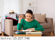 Купить «woman with notebook and travel map at home», фото № 25207748, снято 18 января 2017 г. (c) Syda Productions / Фотобанк Лори