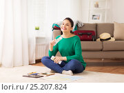 Купить «happy woman with money and travel map at home», фото № 25207824, снято 18 января 2017 г. (c) Syda Productions / Фотобанк Лори
