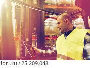 Купить «man with tablet pc operating forklift at warehouse», фото № 25209048, снято 9 декабря 2015 г. (c) Syda Productions / Фотобанк Лори