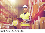 Купить «man with clipboard in safety vest at warehouse», фото № 25209080, снято 9 декабря 2015 г. (c) Syda Productions / Фотобанк Лори