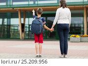 Купить «elementary student boy with mother at school yard», фото № 25209956, снято 24 июля 2016 г. (c) Syda Productions / Фотобанк Лори