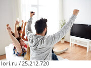 Купить «happy friends with beer watching tv at home», фото № 25212720, снято 14 августа 2016 г. (c) Syda Productions / Фотобанк Лори