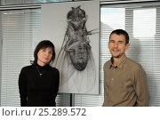 Dr. Krystyna Keleman and Dr Barry Dickson with drawing of Common fruit fly (Drosophila melanogaster), research scientists at the Vienna Drosophila RNAi... Стоковое фото, фотограф Solvin Zankl / Nature Picture Library / Фотобанк Лори