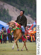 Купить «A Khampa warrior rides his ambling Tibetan stallion during the horse festival, near Huangyan, in the Garze Tibetan Autonomous Prefecture in the Sichuan Province, China, June 2010», фото № 25324044, снято 16 февраля 2020 г. (c) Nature Picture Library / Фотобанк Лори
