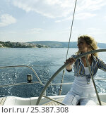 Купить «Woman helming a 46ft sailing yacht, cruising off the Dalmatian Coast in the Adriatic sea, Croatia. July 2006, Model released.», фото № 25387308, снято 22 июля 2018 г. (c) Nature Picture Library / Фотобанк Лори