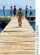 Купить «Boy walking up a pontoon», фото № 25394916, снято 25 мая 2018 г. (c) Nature Picture Library / Фотобанк Лори