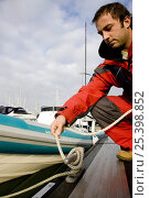 Купить «Man untying rib from marina pontoon, December 2008. Cowes, Isle of Wight. Model Released.», фото № 25398852, снято 16 августа 2018 г. (c) Nature Picture Library / Фотобанк Лори
