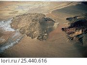 Купить «Aerial view of extinct volcano on the floor of the Great Rift Valley, Kenya», фото № 25440616, снято 5 апреля 2020 г. (c) Nature Picture Library / Фотобанк Лори