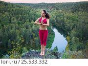 Купить «Young woman doing yoga», фото № 25533332, снято 29 августа 2015 г. (c) Алена Роот / Фотобанк Лори