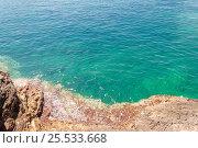 Adriatic sea in sun light. Rock shore of calm sea with clean water. Стоковое фото, фотограф Евгений Пидеркин / Фотобанк Лори
