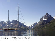 """Купить «180ft Superyacht """"Adele"""" in the Lofoten Islands, Norway. ^^^ Adele is a 180-foot Andre Hoek designed yacht, built by the world renowned Vitters Shipyard in Holland. She is owned by Jan-Eric Osterlund. Non editorial uses must be cleared individually.», фото № 25535748, снято 19 января 2020 г. (c) Nature Picture Library / Фотобанк Лори"""
