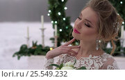Купить «Young woman in white dress near fireplace decoration on frozen lake», видеоролик № 25549232, снято 30 января 2017 г. (c) Алексей Макаров / Фотобанк Лори