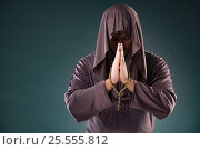 Купить «Monk in religious concept on gray background», фото № 25555812, снято 26 октября 2016 г. (c) Elnur / Фотобанк Лори