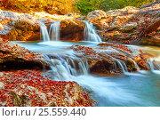 Beautiful waterfall in forest at sunset. Autumn landscape, fallen leaves, water flow. Стоковое фото, фотограф Сергей Семенович Мальков / Фотобанк Лори