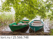 Two fishing boats under green trees in the lake with copy space. Стоковое фото, фотограф Светлана Булычева / Фотобанк Лори