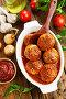 Фрикадельки в томатном соусе в форме для запекания на кухонном столе. Вид сверху, фото № 25567976, снято 14 февраля 2017 г. (c) Надежда Мишкова / Фотобанк Лори
