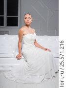 Купить «Thoughtful young bride», фото № 25571216, снято 9 августа 2015 г. (c) Сергей Сухоруков / Фотобанк Лори